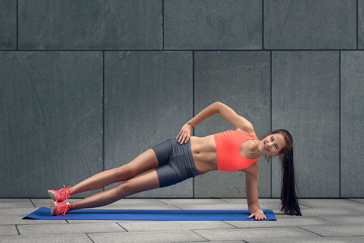 side plank on exercise mat