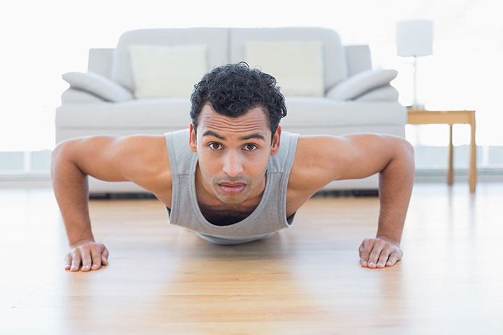 man performs push ups in living room